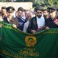 اهتزاز پرچم متبرک حرم رضوی در دهستان چوکام / دیدار خادمین حرم با خانوادهی شهید روحی